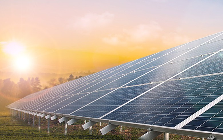 Total buying 50% of Adani Green's 2-GW solar portfolio in India