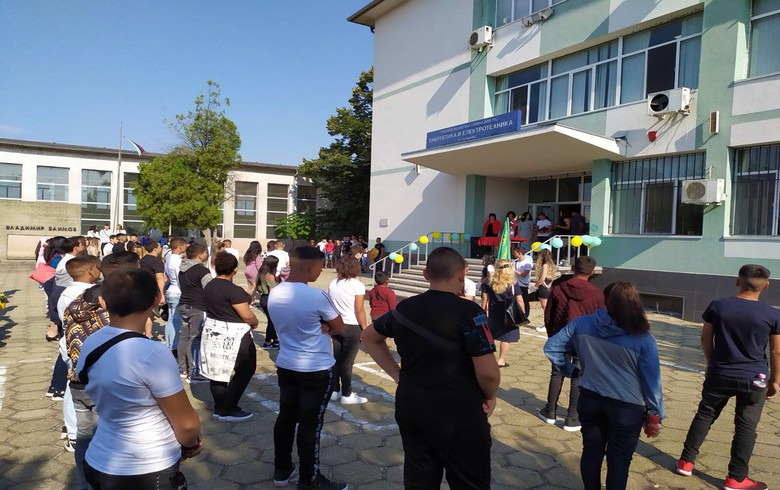 A new English teacher from the USA greets students from Galabovo on the first day of school