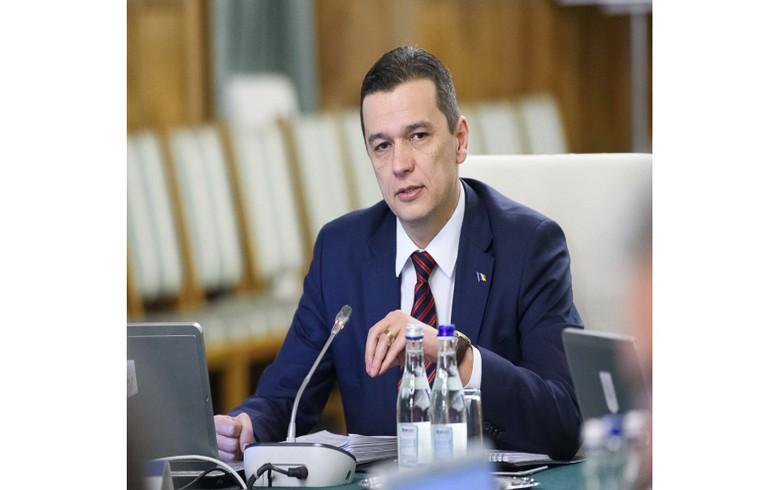 Romania's PM reshuffles government
