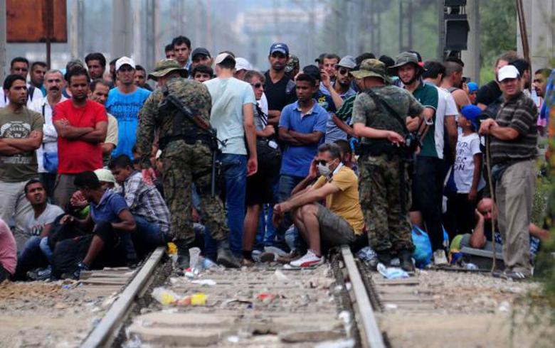 Romanian president Iohannis rejects EU refugees relocation quota
